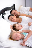 Family in bed Royalty Free Stock Images