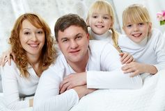 Family on bed Royalty Free Stock Images