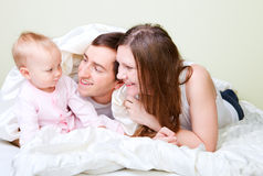 Family in bedroom Stock Images