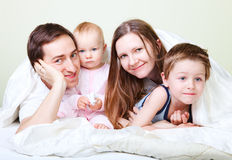 Family in bedroom Royalty Free Stock Images