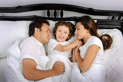 Family in the bedroom Stock Photos