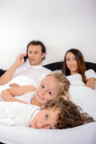 Family in the bedroom Royalty Free Stock Images