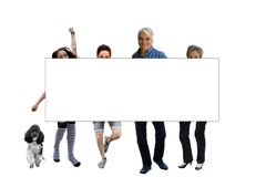 Family behind a white board royalty free stock image