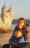 Family in Belem. Mother and baby near Belem tower, Lisbon, Portugal Royalty Free Stock Photo