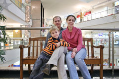 Family on bench in shop Royalty Free Stock Photo