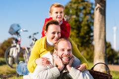 Family with bicycle in park  in fall Stock Photography