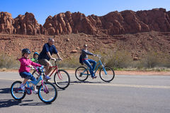Family Bicycle Ride. A mother, Father and two young girls enjoy a bicycle ride together while on vacation in the Southwestern United States Royalty Free Stock Photography
