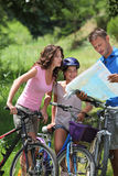 Family on a bicycle ride Royalty Free Stock Photos