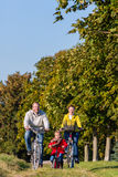 Family on bicycle tour in park Royalty Free Stock Photo