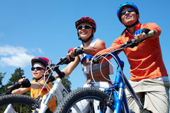 Family on bicycles Stock Photos