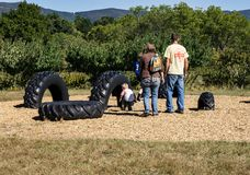 Family in a Big Tire Play Area. Blue Ridge, Virginia USA – September 30th: A small child and his Parents enjoying play in the big tire play area at the Annual Royalty Free Stock Image