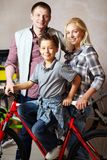 Family with bike Stock Photos