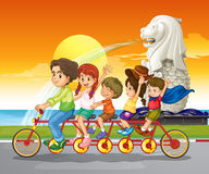 A family bike near the statue of Merlion. Illustration of a family bike near the statue of Merlion Royalty Free Stock Images