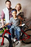 Family with bike Stock Photo