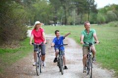 Family bike ride royalty free stock photography