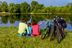 Family bike ride outdoors, active parents and kid cycling royalty free stock photos