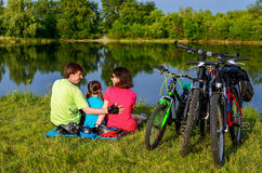 Family bike ride outdoors, active parents and kid cycling Stock Photo
