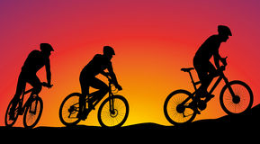 Family on a bike tour - vector silhouette. Vector icons on the background of sunsets vector illustration