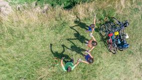Family on bikes cycling outdoors, active parents and kids on bicycles, aerial view of happy family with children relaxing Royalty Free Stock Photography