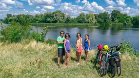 Family on bikes cycling outdoors, active parents and kids on bicycles, aerial view of happy family with children relaxing stock photography