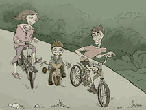 Family on the bikes in the forest Stock Photography
