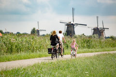 Family on bikes in nature royalty free stock photos