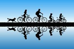 Family on bikes in park royalty free illustration