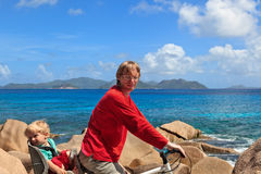 Family on bikes on tropical vacation Royalty Free Stock Photography