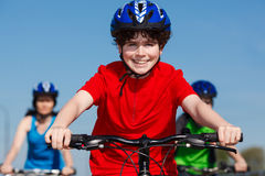 Family biking. Active family - mother and kids biking Stock Photos