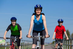 Family biking. Active family - mother and kids biking Stock Photo