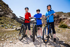 Family biking. Active family - mother and kids biking Royalty Free Stock Images