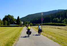 Family biking. On country road in Titisee, germany Stock Photography