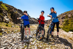 Family biking. Active family - mother and kids biking Royalty Free Stock Image