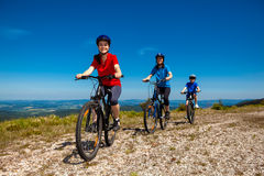 Family biking. Active family - mother and kids biking Stock Photography