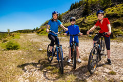Family biking. Active family - mother and kids biking Stock Image