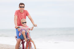 Family biking at the beach Stock Image