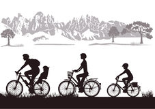 Family biking in countryside Stock Photos