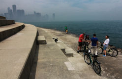 Family Biking on Lake Michigan with Chicago Skyline Stock Photos