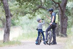 Family biking in the park Royalty Free Stock Images
