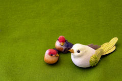 Family birds. A wooden  family birds on green background - with space for text Royalty Free Stock Images
