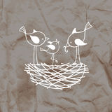 Family birds in a nest, the parents feed their nestling. Stock Photo