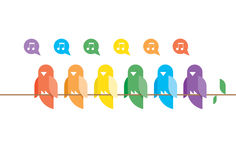 Family of birds in rainbow colors sitting and sing. Ing on a tree branch with green leaves. Nature music concept Royalty Free Stock Images
