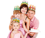 Family in birthday crowns Royalty Free Stock Photo