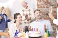 Family birthday party for a dad. Happy family birthday party for a surprised dad stock photos