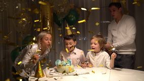 Family birthday party - firework candles cake, colorful streamers confetti fly stock footage