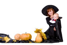 Family  in black halloween cloak with pumpkin Stock Photo