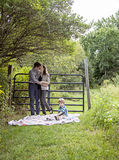Family on blanket in the country Royalty Free Stock Photo