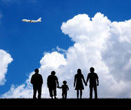Family in the blue sky background. Stock Photo