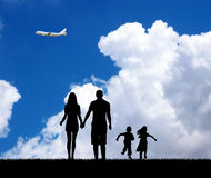 Family in the blue sky background. Stock Photos