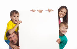 Family with board Stock Images